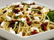Pasta with Fresh Goat Cheese, dried tomatoes and basil